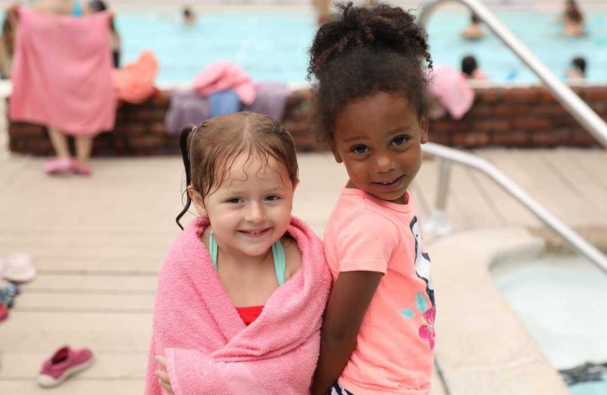 Two Preschool Campers Smiling By the Pool