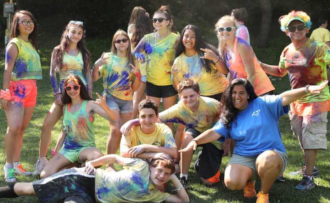 West Hills Day Camp Teen campers Covered in Neon Powder Posing