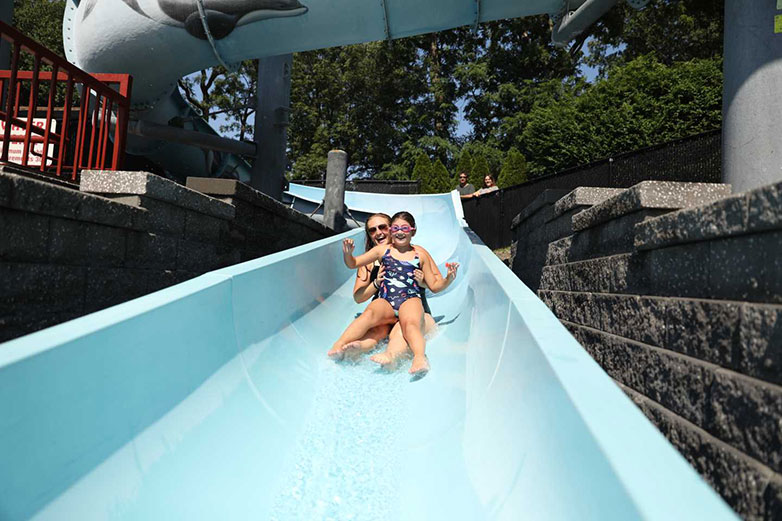 Camper and Parent Sliding Down the West Hills Giant Waterslide Big Blue